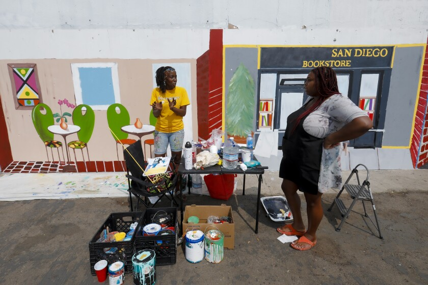Kim Phillips-Pea and Raquel Rhone painted murals in Lincoln Park neighborhood