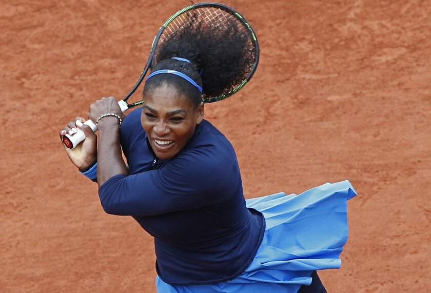 Serena Williams of the U.S. returns the ball in the semifinal match of the French Open tennis tournament against Netherlands' Kiki Bertens at the Roland Garros stadium in Paris, France, Friday, June 3, 2016. (AP Photo/Christophe Ena)