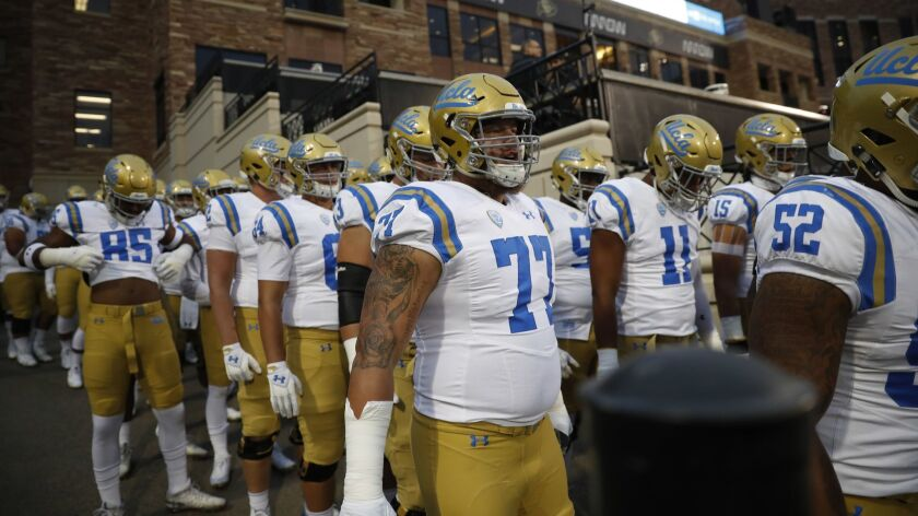 UCLA football players prepare to enter the field before their game against Colorado at Boulder, Colo., on Sept. 28.