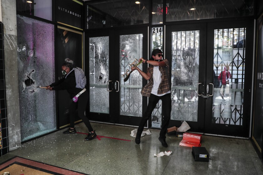 Looters ransack stores in downtown Long Beach on Sunday