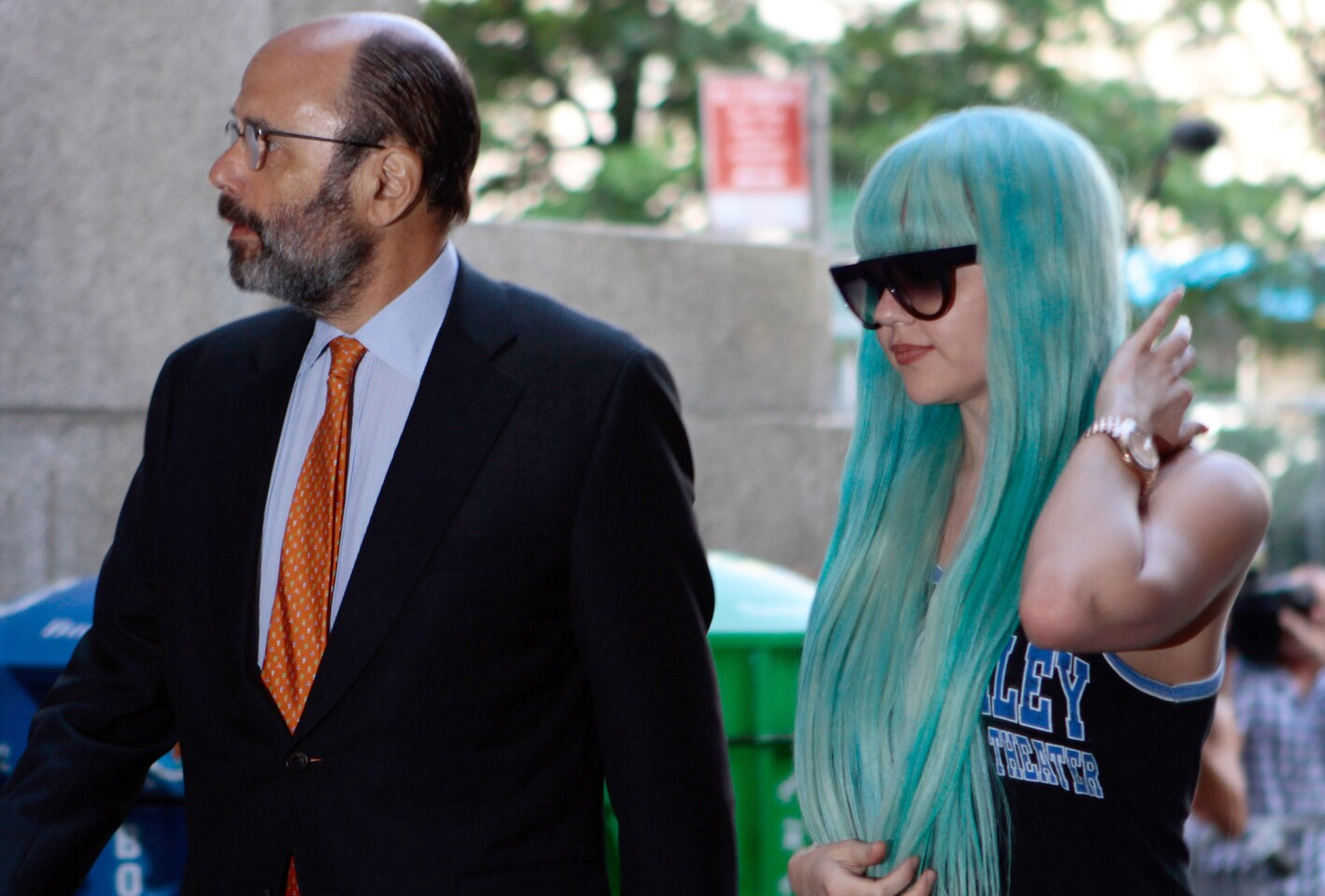 Amanda Bynes, accompanied by attorney Gerald Shargel, arrives for a court appearance in New York in 2013 on allegations that she chucked a marijuana bong out the window of her 36th-floor Manhattan apartment.