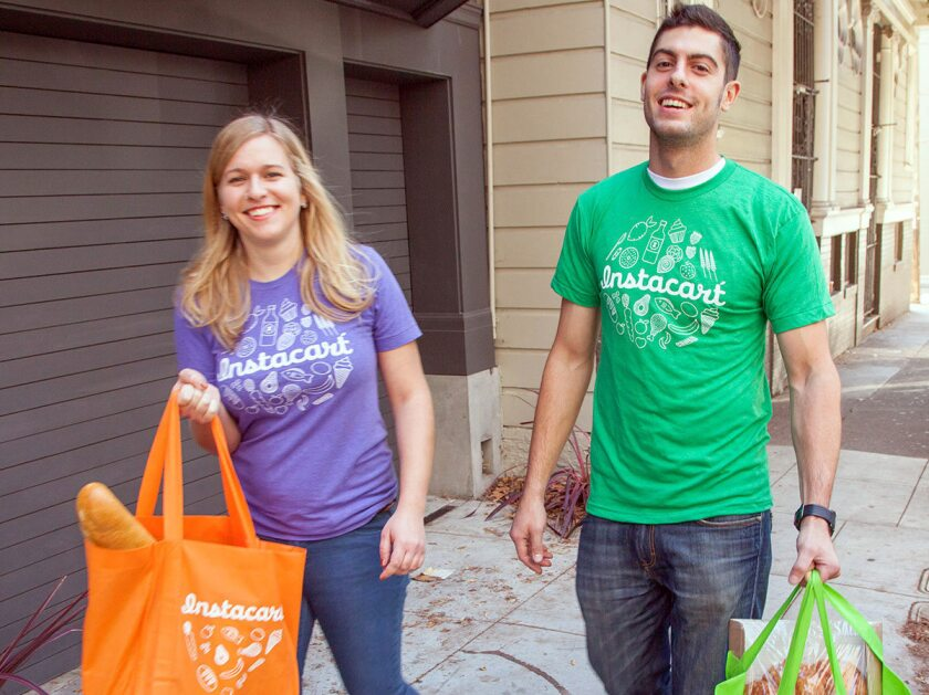 Two Instacart shoppers.