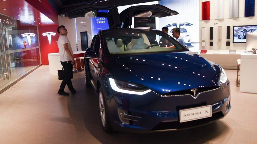 A man visits a Tesla showroom in Beijing on July 4.