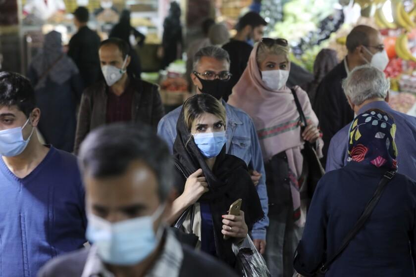 People wearing masks in the Tajrish bazaar in northern Tehran