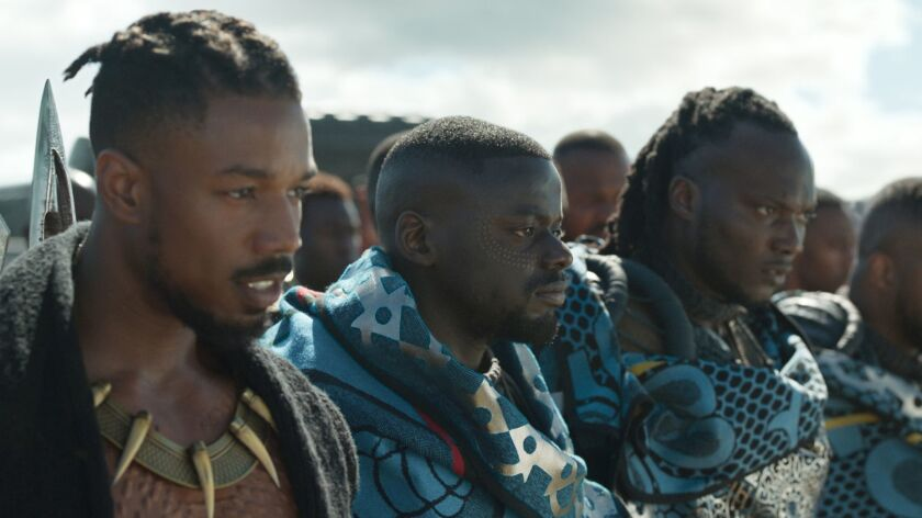 (L-R) - Erik Killmonger (Michael B. Jordan) and W'Kabi (Daniel Kaluuya) with some of his border trib