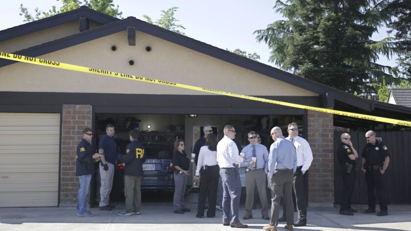 Authorities gather outside the home of suspect Joseph James DeAngelo, Wednesday, April 25, 2018, in