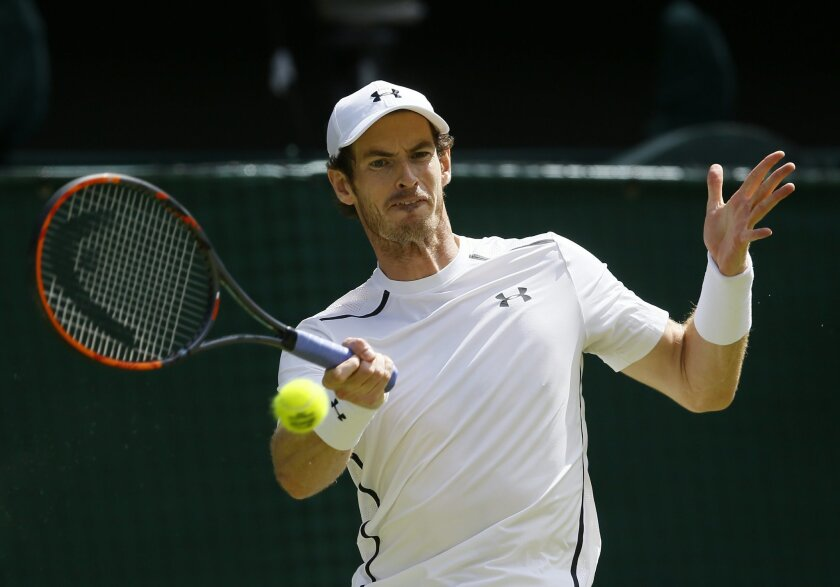 FILE - In this July 10, 2016, file photo, Andy Murray, of Britain, plays a return to Milos Raonic, of Canada, in the men's singles final of the Wimbledon Tennis Championships in London. Wimbledon champion Murray has withdrawn from the Rogers Cup tennis tournament because of fatigue. The world No. 2