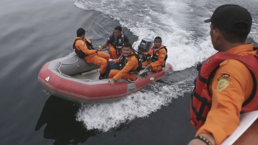 Indonesian rescuers search for a ferry which sank on Monday in Lake Toba, North Sumatra, Indonesia W