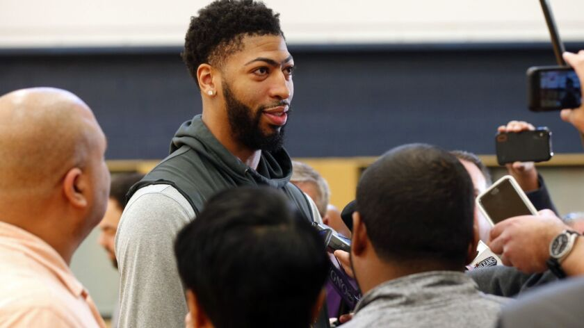 New Orleans Pelicans forward Anthony Davis talks to reporters after their NBA basketball practice in