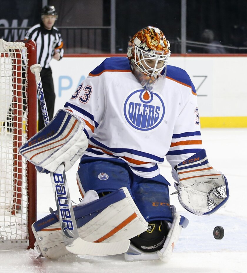 Edmonton Oilers goalie Cam Talbot (33) makes a save in the second period of an NHL hockey game against the New York Islanders in New York, Sunday, Feb. 7, 2016. (AP Photo/Kathy Willens)