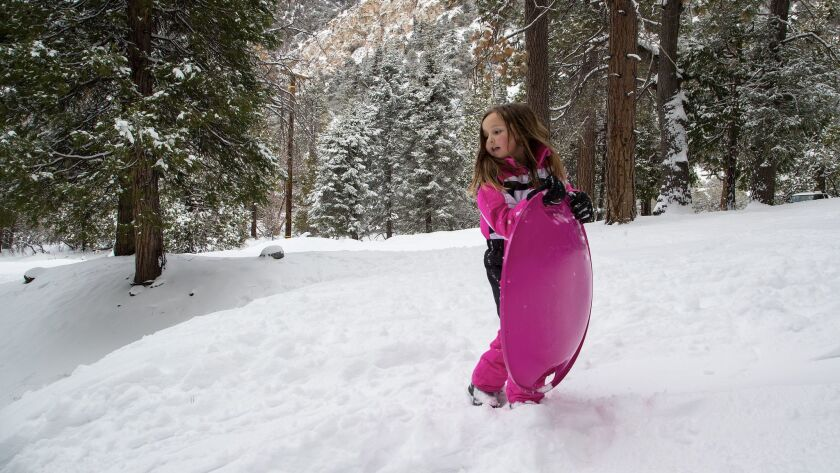 FORWST FALLS, CA - FEBRUARY 27, 2018: Peyton Williams,6, of Forest Falls looks down a snow covered s