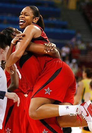 Tina Thompson embraces Sylvia Fowles as the U.S. women's basketball team wins the gold medal with a victory over Australia at the 2008 Beijing Olympics.