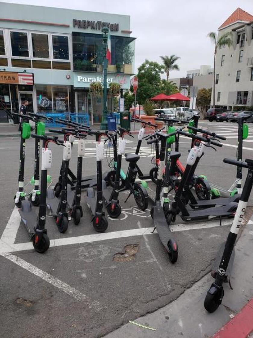 A scooter corral in Little Italy, similar to those the City would like to install in La Jolla