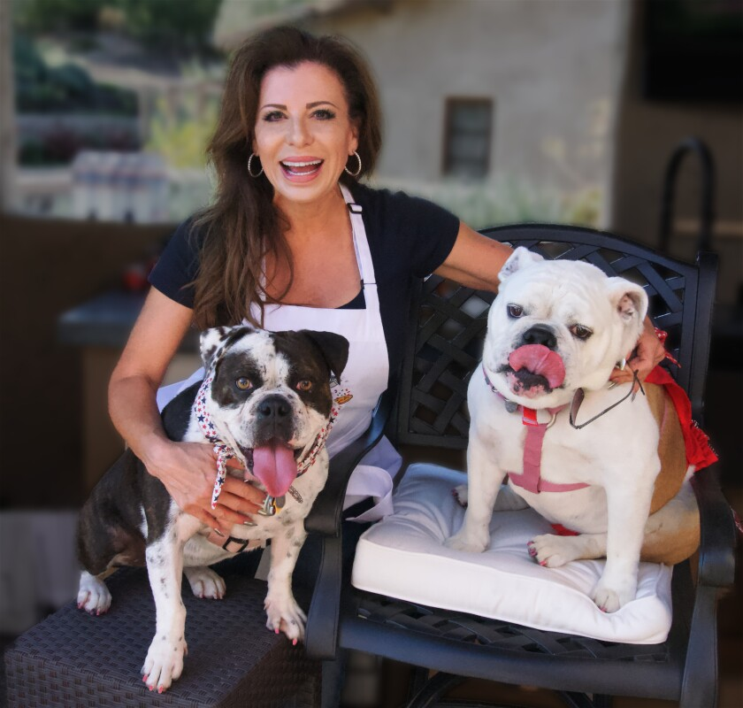 Holli Lienau with her two bulldogs.