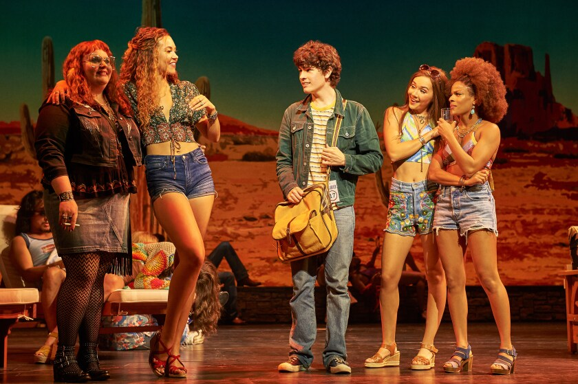 """Katie Ladner as Sapphire, left, Solea Pfeiffer as Penny Lane, Casey Likes as William Miller, Julia Cassandra as Estrella and Storm Lever as Polexia in """"Almost Famous,"""" the musical having its world premiere at the Old Globe in San Diego."""