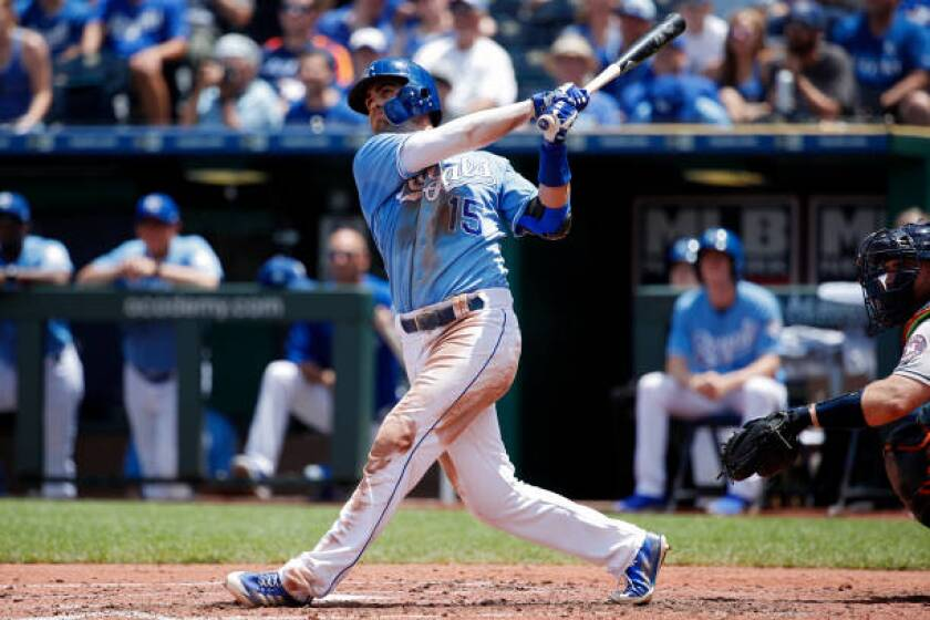 Kansas City Royals second baseman Whit Merrifield bats during a game against the Astros.