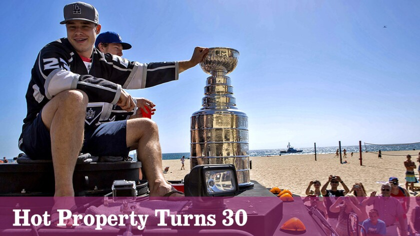 Dustin Brown and the Los Angeles Kings ride through Hermosa Beach during a Stanley Cup victory parade.