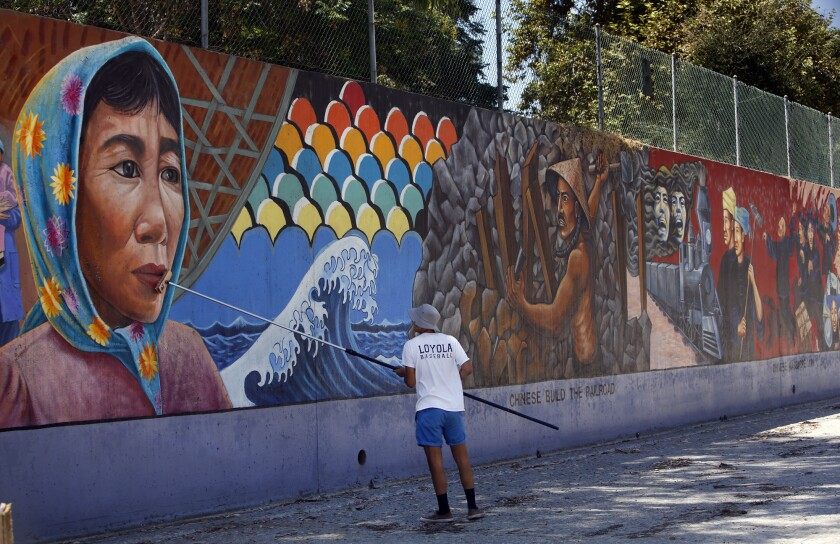 "A representative from the Social and Public Art Research Center, or SPARC, cleans Judith Baca's ""The Great Wall of Los Angeles"" in 2014. Baca is the first muralist to win one of United States Artists' $50,000 awards."
