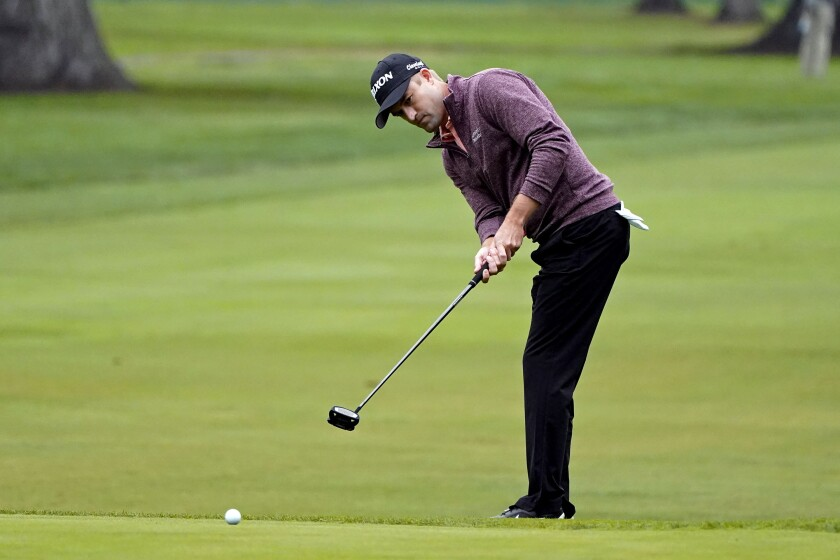 Russell Knox, of Scotland, putts up to the 13th green of the Silverado Resort North Course during the first round of the Safeway Open PGA golf tournament Thursday, Sept. 10, 2020, in Napa, Calif. (AP Photo/Eric Risberg)