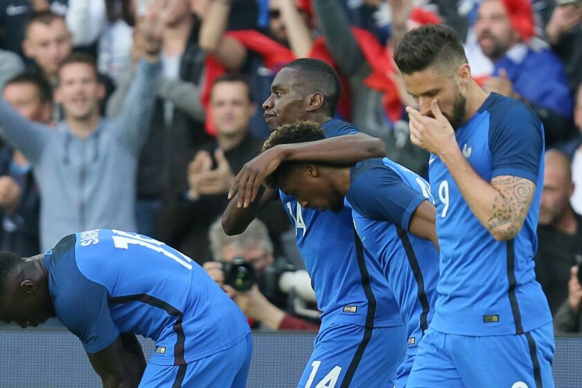 France's Blaise Matuidi, center, celebrates with teammates after scoring the first goal during a friendly soccer match between France and Cameroon at the La Beaujoire Stadium in Nantes, western France, Monday, May 30, 2016. The French squad is in preparation for the EURO 2016 soccer championships w