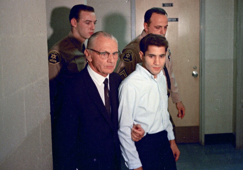 FILE - This June 1968 file photo shows Sirhan Sirhan, right,  with his attorney Russell E. Parsons in Los Angeles.