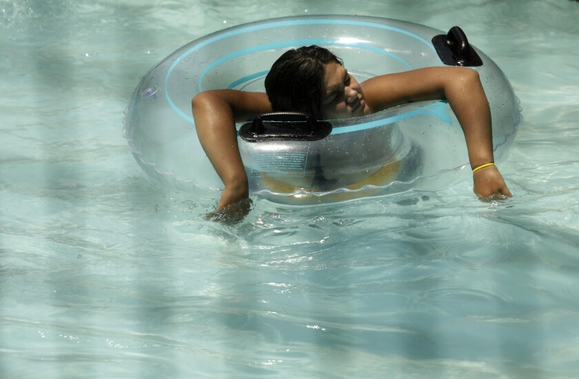 A woman cools off at DryTown Water Park in Palmdale, where the temperature reached 107 degrees by 3 p.m. Sunday.