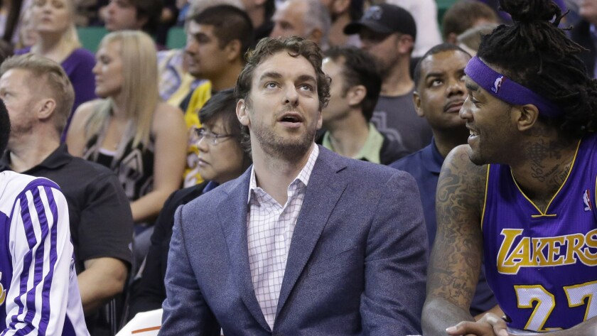 Lakers center Pau Gasol, left, speaks with teammate Jordan Hill on the bench during a game against the Utah Jazz in April.