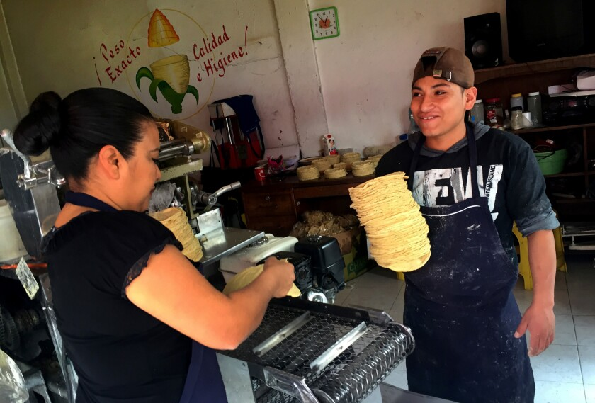 Sophia Cruz (in the black shirt and apron), who owns a corner store called Tortillaría Mexico in N