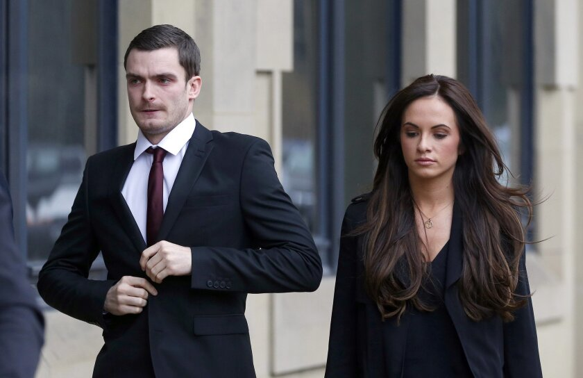 Former Sunderland and England soccer player Adam Johnson, 28, arrives with partner Stacey Flounders at Bradford Crown Court, in Bradford, England, Friday Feb. 12, 2016, where he will stand trial accused of sexual activity with a child.  Johnson has pleaded guilty to grooming and sexual activity wit