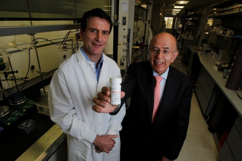 Left, Dominic Behan, Arena Pharmaceutical's executive vice president and chief scientific officer; and Jack Lief, CEO, with bottle of Belviq.