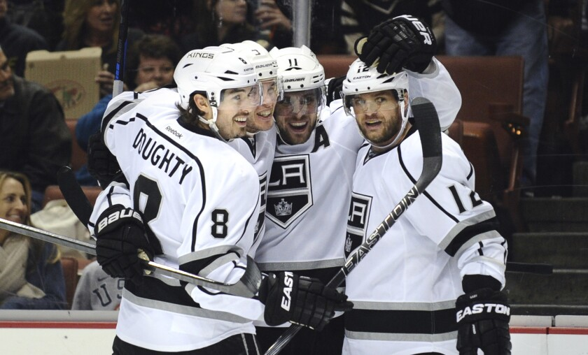 Kings teammates, from left, Drew Doughty, Brayden McNabb, Anze Kopitar and Marian Gaborik celebrate a goal by McNabb in the second period Friday night in Anaheim.