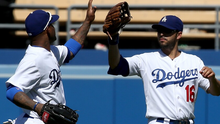 Dodgers outfielders Carl Crawford, left, and Andre Ethier celebrate after a 2013 win. Crawford has had more starts in left field than Ethier has had in recent games.
