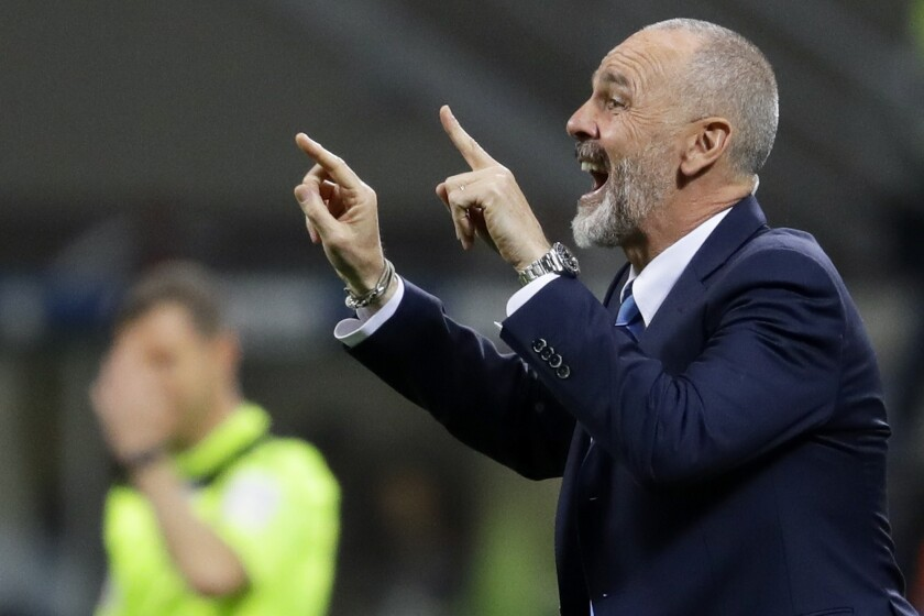 FILE - In this Monday, April 3, 2017 file photo, Inter Milan coach Stefano Pioli gives indications to his players during a Serie A soccer match between Inter Milan and Sampdoria, at the San Siro stadium in Milan, Italy. AC Milan has hired Stefano Pioli as its new coach on a two-year contract. Pioli, who has previously coached the Rossoneri's city rival Inter Milan, replaces the fired Marco Giampaolo. (AP Photo/Antonio Calanni, File)