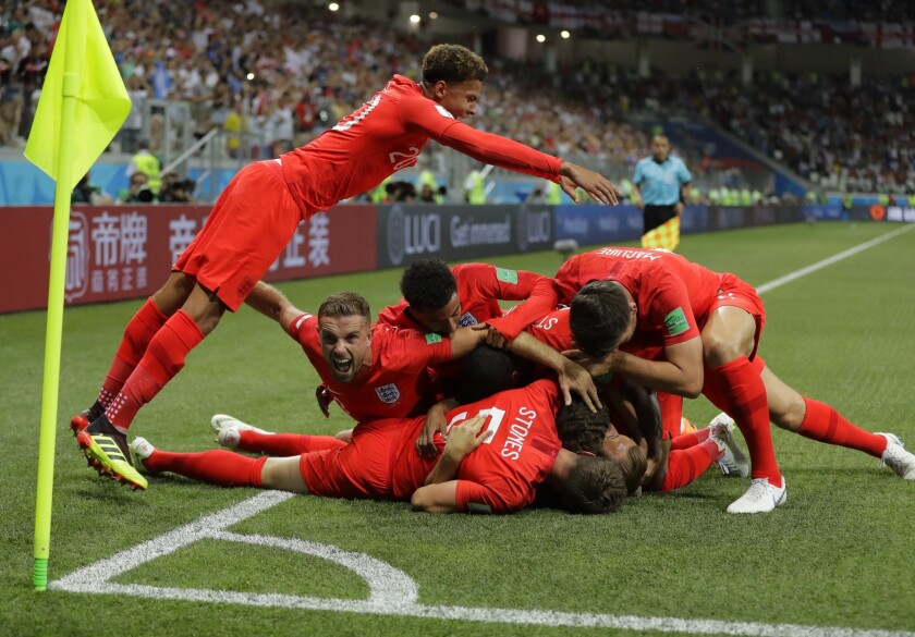 England's team celebrates after scoring the opening goal against Tunisia during the Group G match in the Volgograd Arena in Volgograd, Russia, Monday, June 18, 2018.