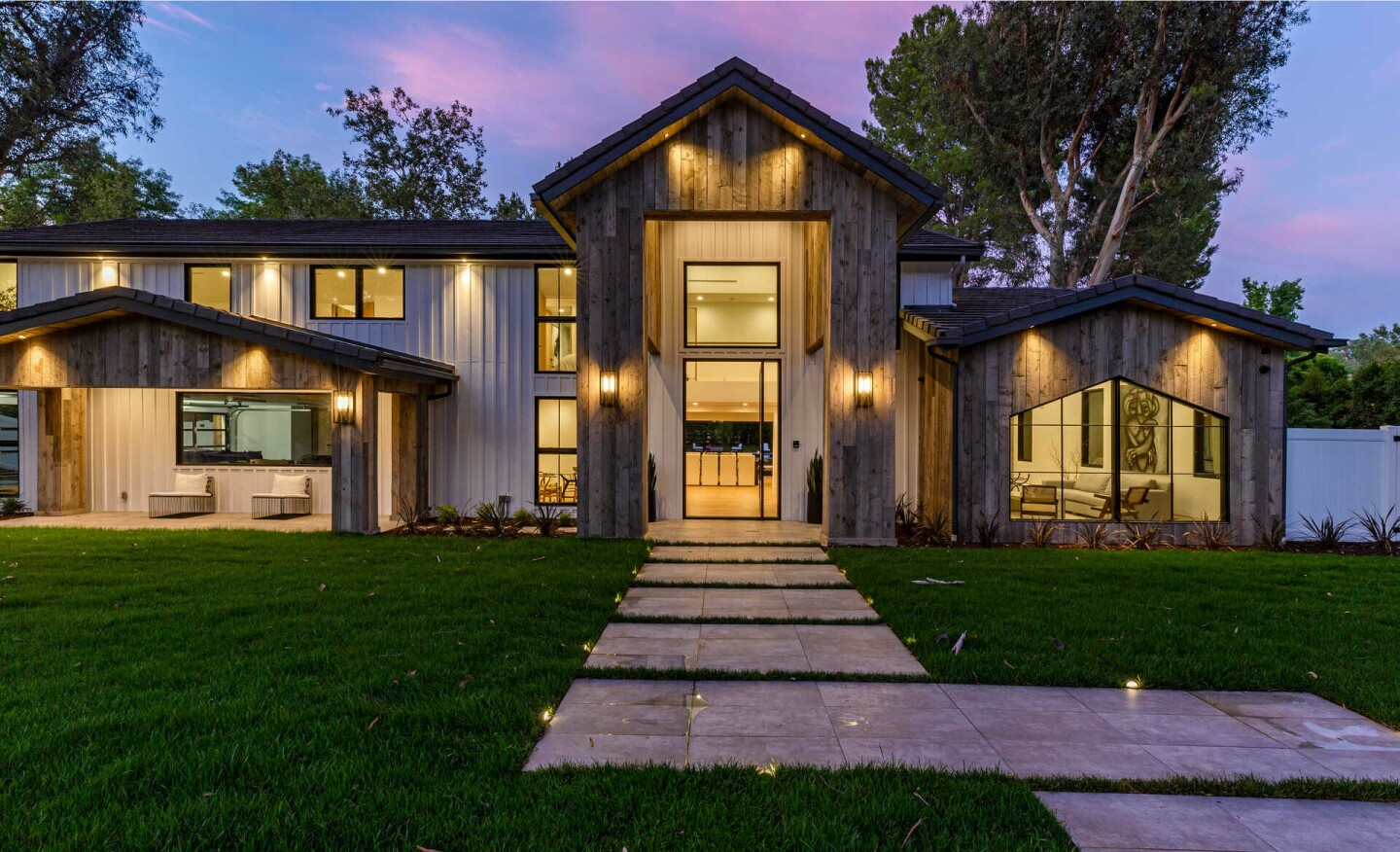 Recently remodeled, the 5,663-square-foot retreat includes a massive open floor plan, two primary suites, a reclaimed wood pavilion and pool.