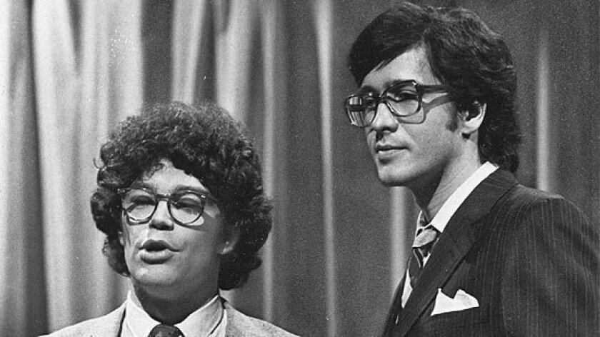 """This 1978 photo shows """"Saturday Night Live"""" writer/performers Al Franken, left, and Tom Davis."""