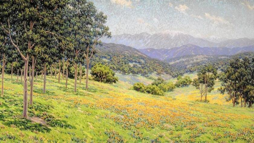 """Granville Redmond's """"California Landscape With Flowers"""" dominates the entrance to The Irvine Museum."""