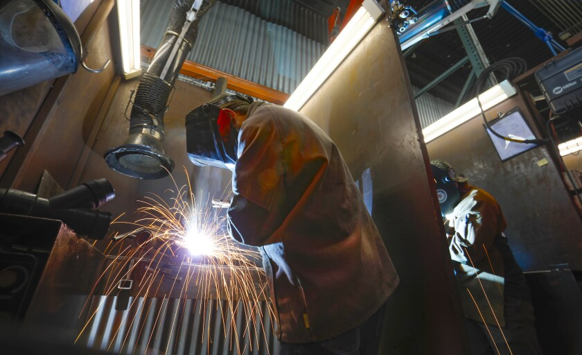 Students at Workshops for Warriors, a nonprofit that trains veterans for jobs in manufacturing, work on gas medal arc welding as part of a certification process on Nov. 6, 2019. The facilities in Barrio Logan are expanding.