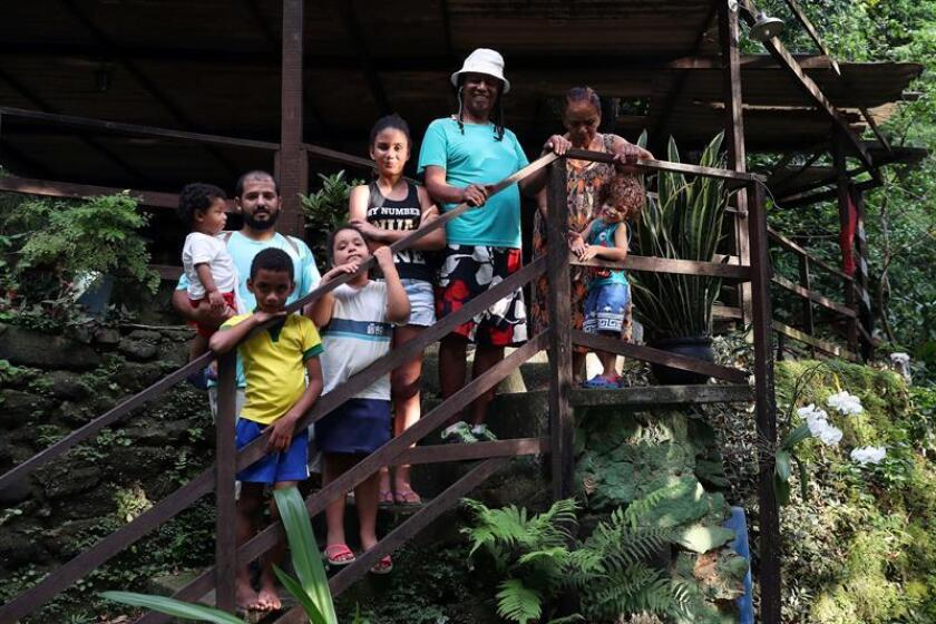 Photo taken Nov. 14, 2018, of the family of Luiz Sacopa, descendents of African slaves surviving in one of the most sought-after residential districts of Rio de Janeiro, and who have long fought the real estate speculation that for years has tried to kick them out of their homes. EFE-EPA/Marcelo Sayao