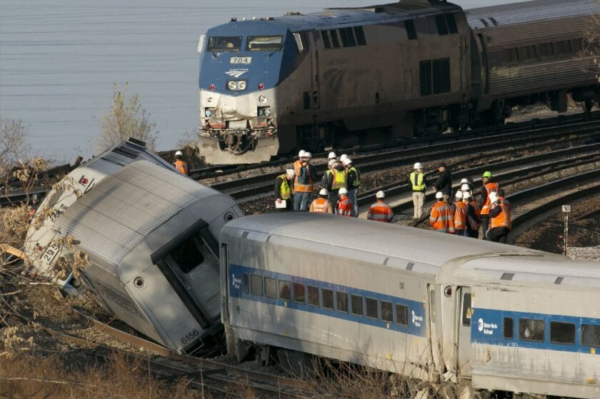 """An Amtrak train rounds a curve near the site of a Metro-North Railroad derailment on Dec. 1, 2013, which killed four passengers. The National Transportation Safety Board says the engineer of the derailed train suffered from """"severe"""" sleep apnea."""