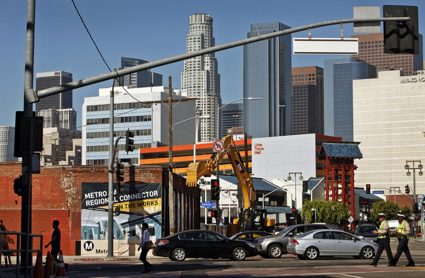 Construction began Tuesday on a rail project that will include a station at 1st and Central streets in Little Tokyo.