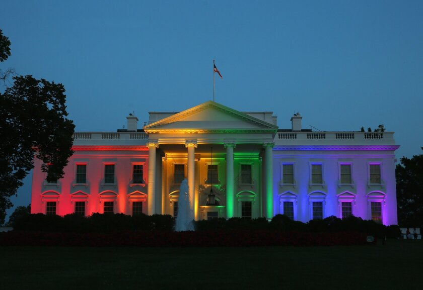 Rainbow-colored lights shine on the White House after the Supreme Court ruling in favor of same-sex marriage on June 26.