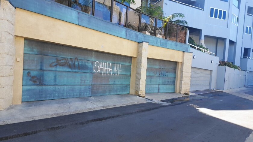 Eight homes in Corona del Mar were vandalized with graffiti between Wednesday night and Thursday morning, according to police.