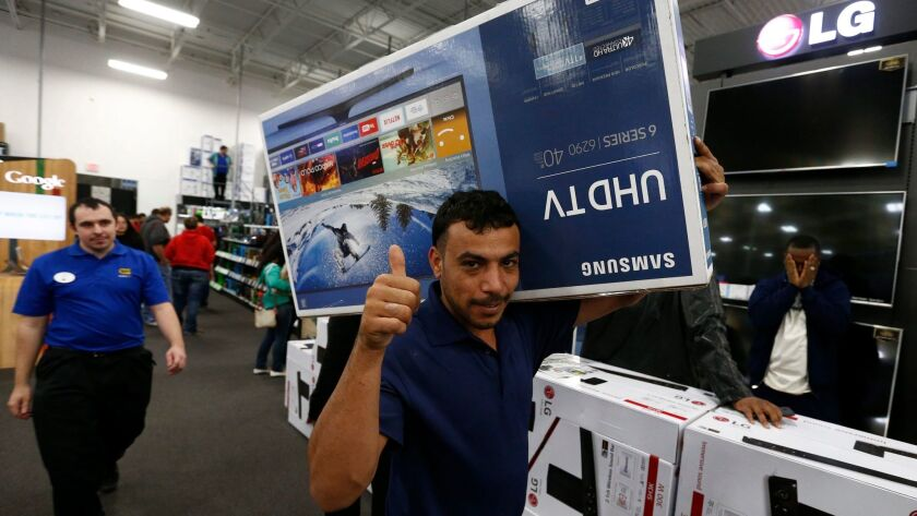 TV deals should abound as the Super Bowl approaches, just as they did around Thanksgiving, when these shoppers in Mesquite, Texas, took advantage of low prices.