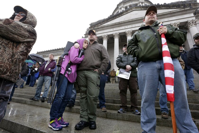 In Olympia, Wash., gun-rights advocates protest President Barack Obama's recent executive actions such as an expansion of background checks.