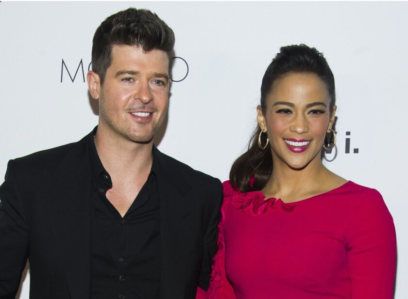 """FILE - In this Wednesday, Oct. 23, 2013 file photo, Robin Thicke and Paula Patton attend the sixth annual GQ Gentlemen's Ball in New York. Patton has filed for divorce from Thicke and is asking for joint custody of their son. Patton filed in Los Angeles on Friday, Oct. 3, 2014, citing """"irreconcilable differences."""" (Photo by Charles Sykes/Invision/AP, file)"""