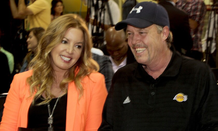 Jeanie and Jim Buss smile during a news conference in El Segundo announcing Dwight Howard as a member of the Lakers on Aug. 10, 2012.