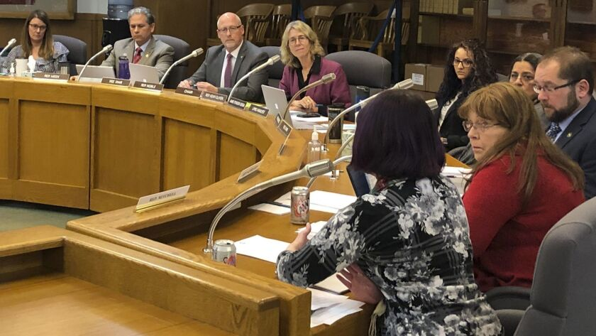 In this photo taken Wednesday, Feb. 20, 2019, a committee of the Oregon House of Representatives deb