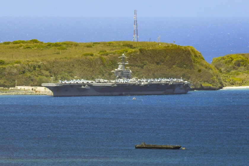 The Theodore Roosevelt, a Nimitz-class nuclear-powered aircraft carrier, docked along Kilo Wharf of Naval Base Guam in April.