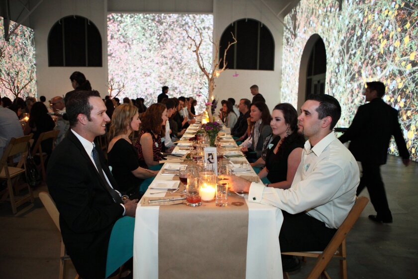 As part of its Summer Solstice Soiree, MCASD La Jolla's Avant Garde members enjoyed a three-course dinner with beer pairings from Stone Brewery, amidst a dramatic video installation by artist Jennifer Steinkamp. Courtesy photos